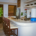 """Tropical Chic"" condo in Zihuatanejo's Madera Beach - Kitchen and bar area open to the terraza."