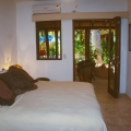 """Tropical Chic"" condo in Zihuatanejo's Madera Beach - The master bedroom opens to the covered terraza."